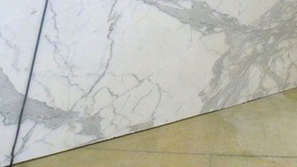 How are marble slabs installed?