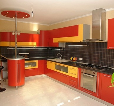 Modular Kitchen with yellow-orange shades for a stylish look