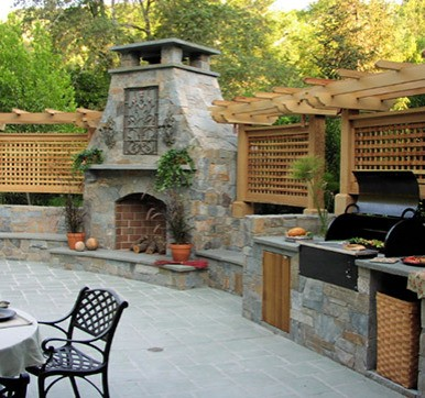 Out door kitchen design with grill and  pizza oven